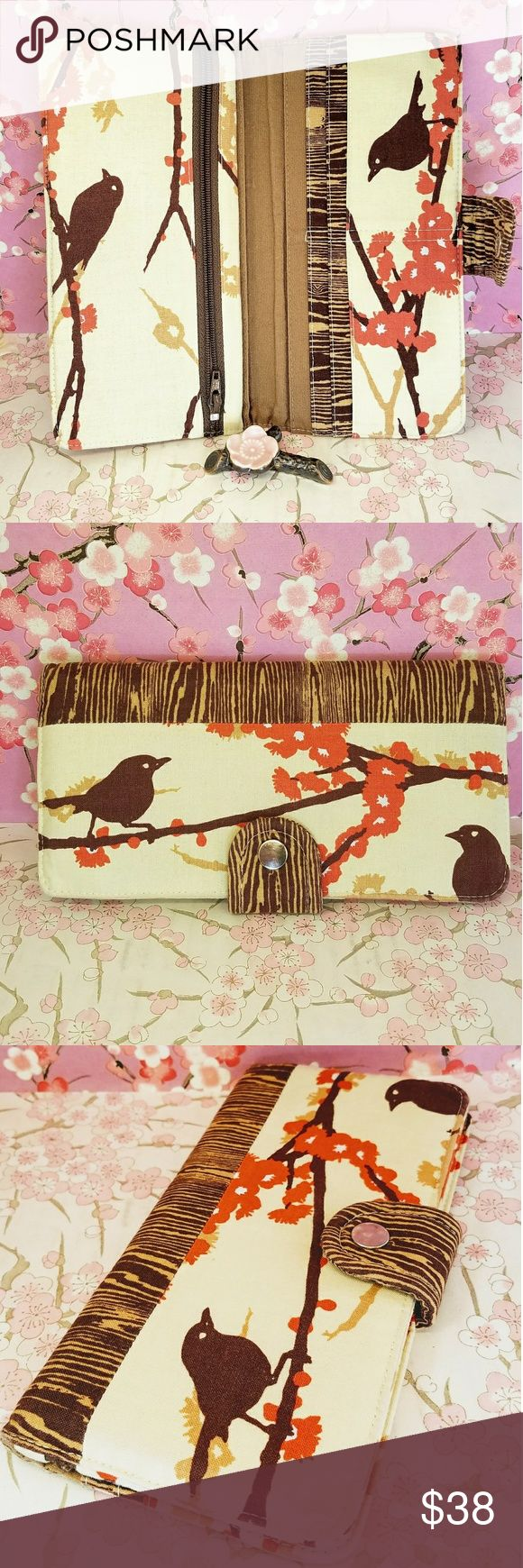 """Cotton Purr bird log orange beige brown wallet Beautiful hand made Cotton Purr bird log orange beige brown wallet. 1 interior zipper pocket on side. 9 interior pockets. Made if cotton. Bird on orange cherry bloss branch design design. Very slim fits in most purses. Size 7.9""""x4"""". Gently used condition. Machine washable. Cotton Purr Bags Wallets"""