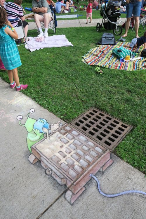 Sluggo demonstrates his waffle-making skills at the Ann Arbor Summer Festival while a hungry pigasus looks on.