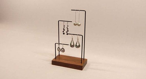 Earring Display This earring display is a perfect way to show your special earrings. It features room for four pairs of earrings of various