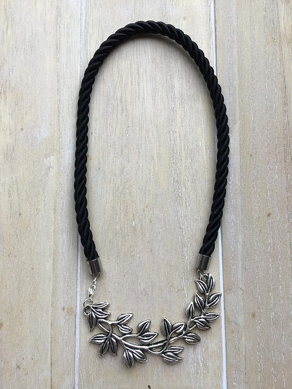 Short statement necklace made of rope, black twisted silk cord with a big branch pendant.