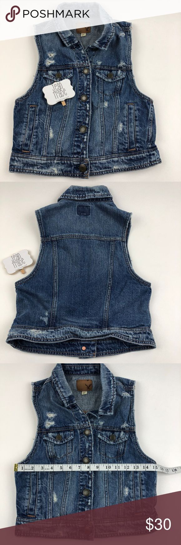 AE American Eagle Denim Vest AE American Eagle Denim Vest. Sleeveless Jean Vest. See photos for measurements. GC  Washed cotton denim Collar neck with full button front Dual chest pockets with button closure Sleeveless Dual hip pockets American Eagle Outfitters Jackets & Coats Vests