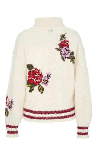Rendered in alpaca, this **Leur Logette** sweater features a turtleneck, full length sleeves with red stripes at the cuffs and hem, and a floral design at the bodice.