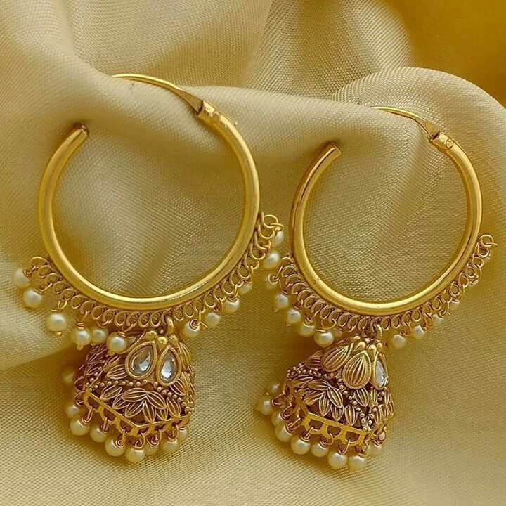 Golden earrings with pearl finish