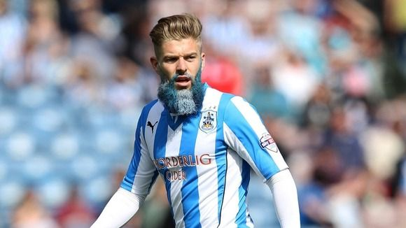 Huddersfield Town's Adam Clayton sported a colourful beard, all in aid of charity. He earned £3,000 for the Huddersfield Town Foundation charities.