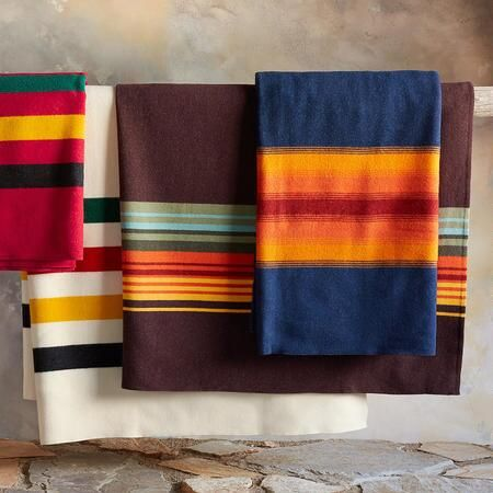 "Sundance Catalog  National Parks blankets by Pendleton  Item No. 72450 $225.00    Making heirloom quality blankets since the early 20th century, Pendleton Woolen Mills celebrates our national heritage in warm, soft blankets commemorating our great national parks. Woven in virgin wool, each is inspired by the unique beauty, character and colors of the parks. Dry clean. USA. 80"" x 90""."