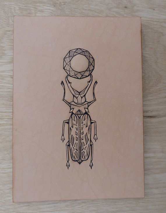 Tattooed leather art. Handmade. Inked. Original artwork. Geometric beetle insect with mandala in christmas gift box. Tattoo