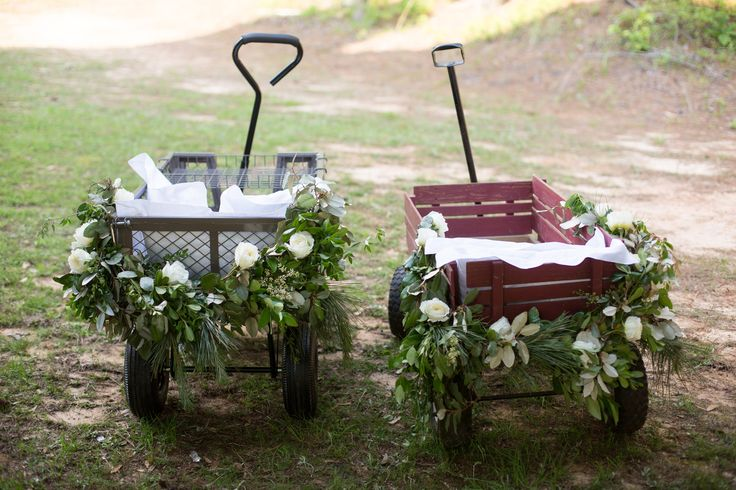Flower girl and ring bearer wagons. Floral and Event Design by Greg Boulus Events. Augusta, GA. Image by Robin Gerrard Photography.