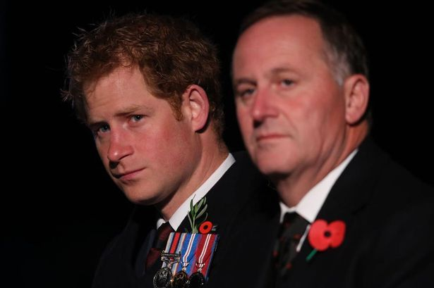 Tribute: Prince Harry and New Zealand Prime Minister John Key, right, at a Spirit of Place Ceremony and Dawn Service