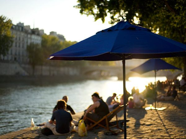 The banks of Paris' majestic river artery transform into a Seine-side beach holiday.