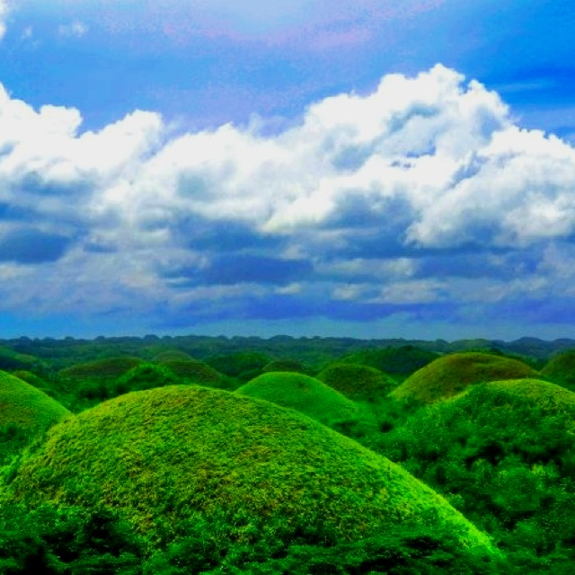 The world-renowned cone-shaped Chocolate Hills is Nature's expression of beauty, mystery and romance. (Bohol, Philippines)