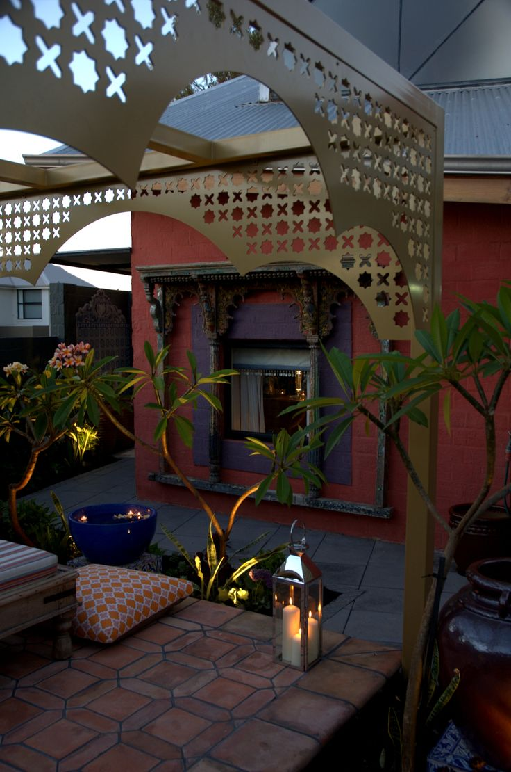 Golden pergola frames the view in this Moroccan #gardendesign