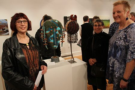 """""""My heart is at Mercer County College,""""declared Janis Purcell, left, pictured next to her Best in Show wood and mixed media sculpture """"Diva."""" Also pictured are Arlene Milgram, another featured artist, and Kelsey Theatre Artistic Director Kitty Getlik.(Mercer County Artists 2016 exhibit)."""