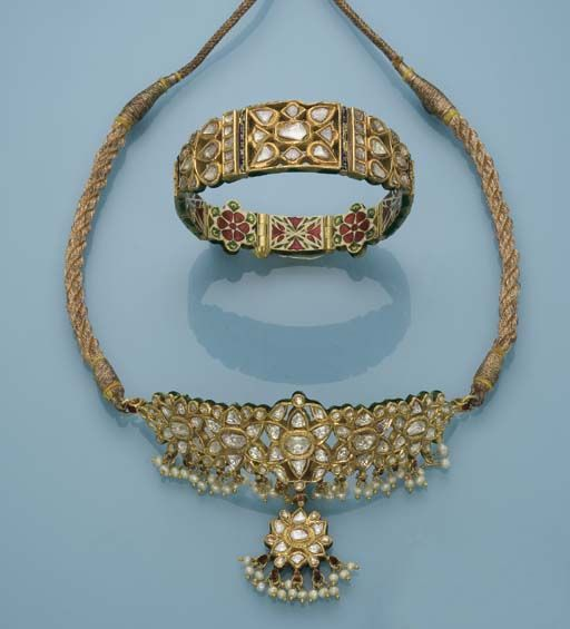 AN INDIAN ENAMEL AND DIAMOND NECKLACE AND BRACELET The diamond necklace panel and pendant suspending seed pearl tassels to the enamelled reverse and gold cord, the diamond and enamel bracelet en suite, necklace panel 9.0 cm long, bracelet 16.0 cm long #Indian #Jewellery
