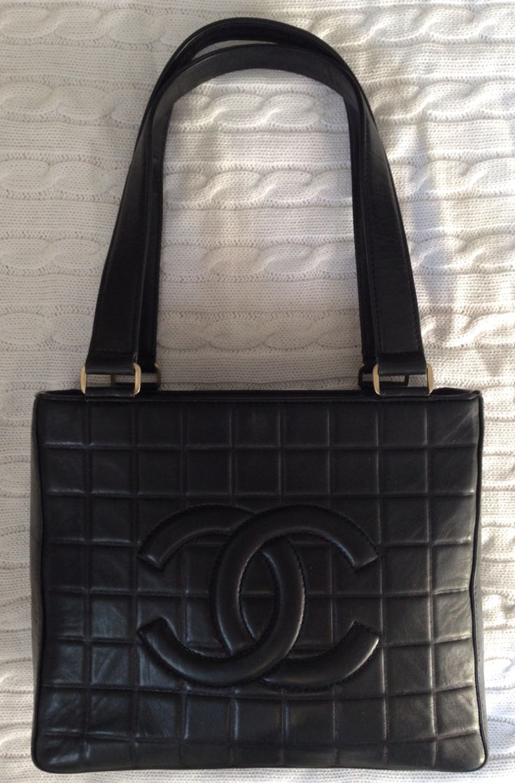 Vintage 1990s Chanel quilted black leather bag with logo