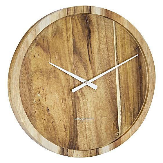 For effortless style to exude warmth and practicality in your space opt for the acacia wood Pure Wall Clock from London Clock Company.