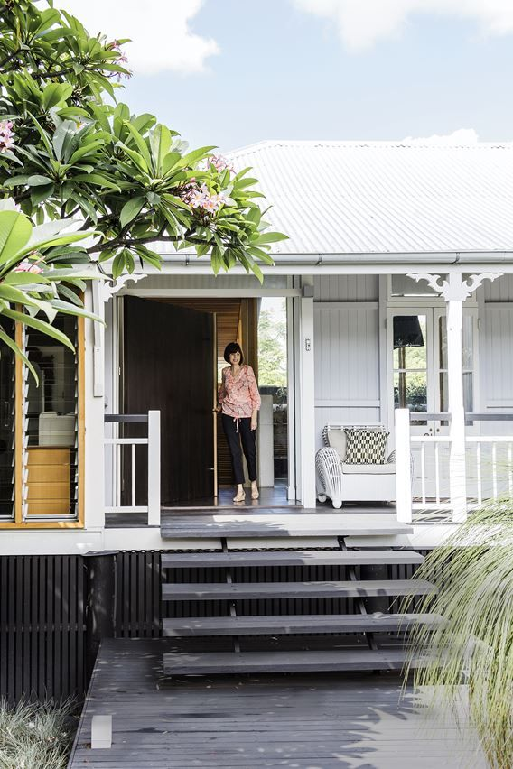 "Homeowner Mary Zahos on the porch of the original weatherboard cottage. The oversize front door offers the only hint of the contemporary design inside. **Chair** from [St Barts](http://www.st-barts.com.au/?utm_campaign=supplier/|target=""_blank"")."