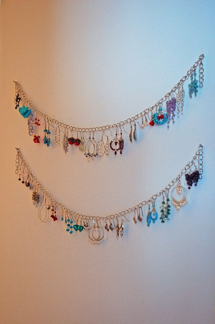 Easy, pretty earring storage. Use sewing pins to hook them to the walls for a low-visibility.