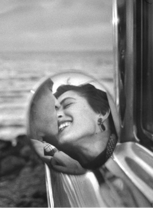 The original wing mirror shot that launched them all... USA. 1955. California by Elliott Erwitt