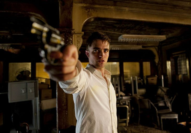 The chaotic way the background is lit. This is very apocalyptic, I adore it. The destruction behind him plays with the vague rationality in his face (the white light) and the yellow on the other side. His gun is on the rational side, but he's facing the other.