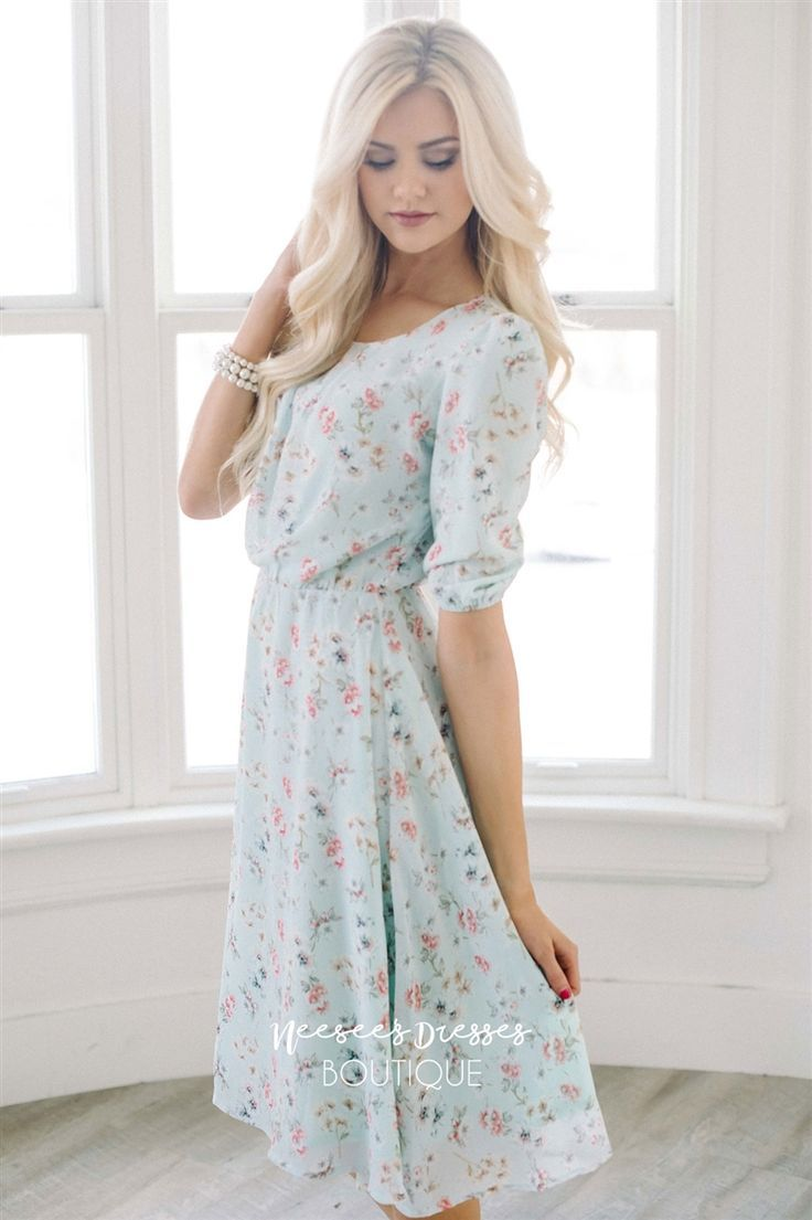 This dress is beyond beautiful! The pastel colors are so soft and
