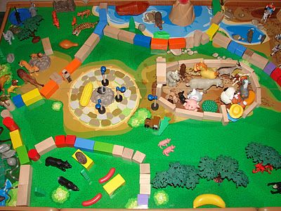 using blocks and toys from all playsets to build a zoo