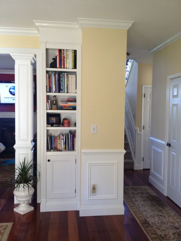 Built-in bookcases. Would love to do this in the arch from entry to family room. There is dead space behind the wall.