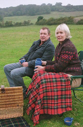 John Nettles and Jane Wymark on the set of 'Midsomer Murders' in 'Down Among the Dead Men' episode.