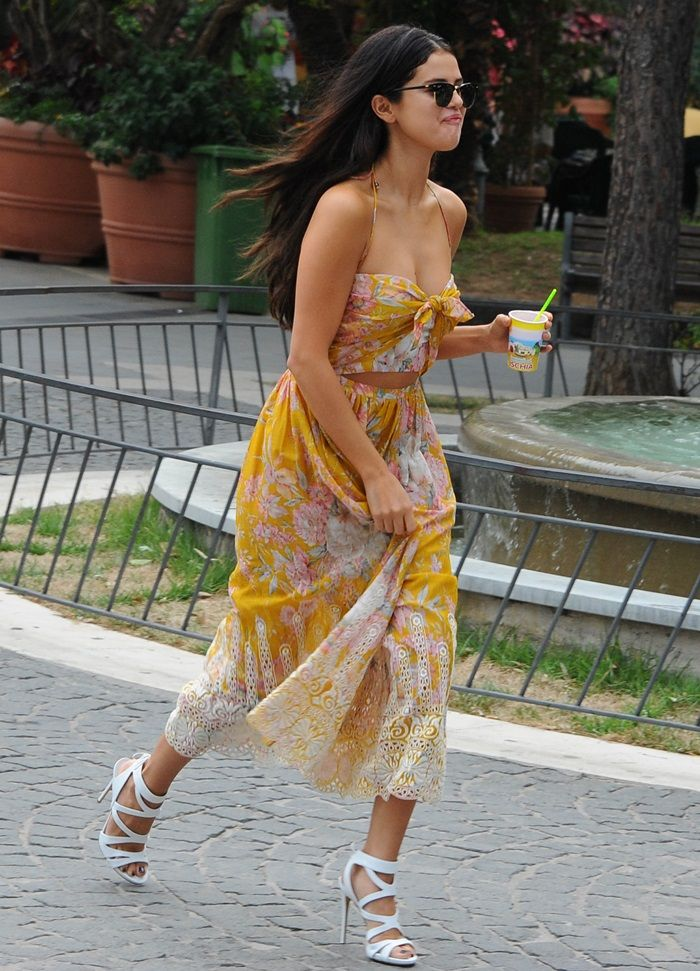 Selena Gomez paired the piece with Ray-Ban Club sunnies and gorgeous white strappy sandals