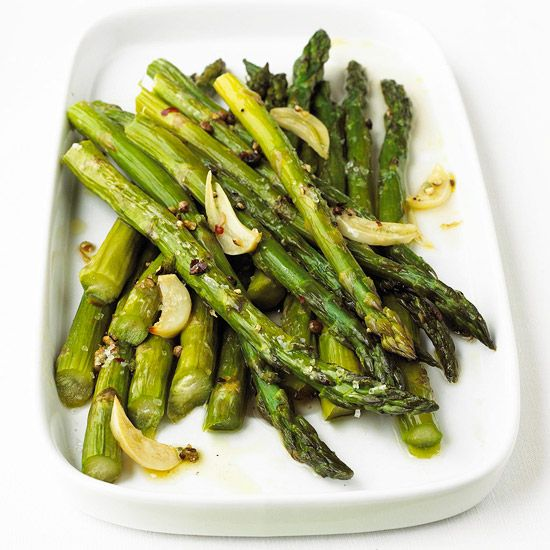 Garlic-Roast Asparagus couldn't be easier: Toss asparagus with a few spices, and roast until tender. More asparagus recipes: http://www.bhg.com/recipes/party/seasonal/asparagus-recipes/ #myplate #veggies