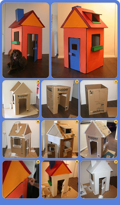 Das Erstellen eines Hauses aus einem Karton und ei…