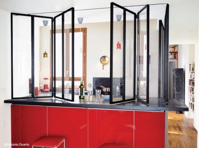 Cloison transparente repliable pour une cuisine semi-ouverte