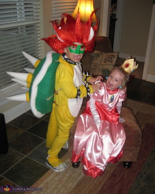 Bowser - I like the mask and wig vs. the full head. Also, this picture is hilarious.