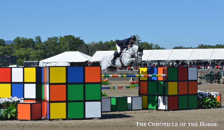 Photo by Molly Sorge The inventive Rubik's Cube jump, shown here with Beat Mandli and Antares F over it, was a crowd-pleaser. | The Chronicle of the Horse