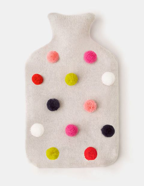 Long, cold nights call for a truly excellent hot water bottle. This one is covered with a soft lambswool-mix fabric that's perfect for cuddling up to on the sofa or warming chilly toes in bed. Playful embroidery or pompoms add a festive finishing touch.