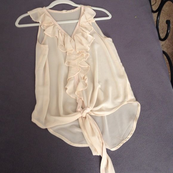 ❤️CREAM/BEIGE RUFFLE TANK❤️ Absolutely BEAUTIFUL tank top with Ruffles all down the front. There are little beads sewn into it. There's also a tie at the bottom. It's a sheer material so you'd definitely need a light bandeau or tank beneath it Tops Tank Tops