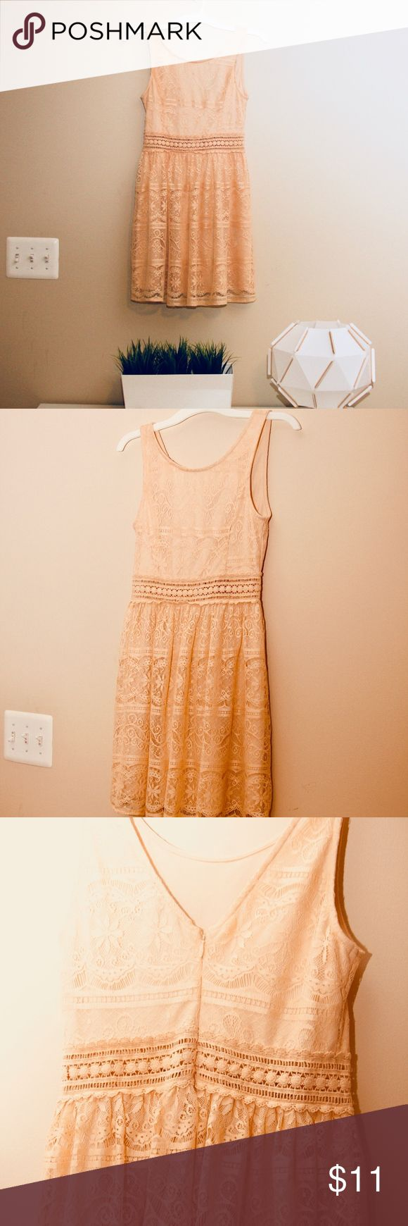 """Forever 21 Mini/Midi Peach Lace Dress XS to Small Forever 21 Mini/Midi Peach Lace Dress Great for weddings, casual events, or a night out on the town! Never worn, however tags are not attached. The 3rd picture shows the zip enclosure on the back of the dress  I would suggest this dress for someone who has a smaller chest. Even though it's a small, it fits more like an extra small. 32.5""""  in length from the top of the strap, 27"""" in width from the waist band The waist band in the middle…"""