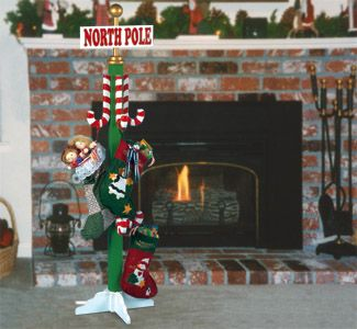 North Pole Stocking Holder Pattern The whole family can hang their Christmas stockings together on this colorful project. #diy #woodcraftpatterns