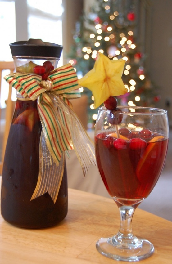 Christmas Sangria 2 bottles Merlot 1 bottle ginger ale 1 cup sugar 1 tsp ground cinnamon ½ tsp ground nutmeg ½ tsp ground clove 4 to 6 oranges or tangelos 6 to 10 cinnamon sticks 1/2 bag of cranberries