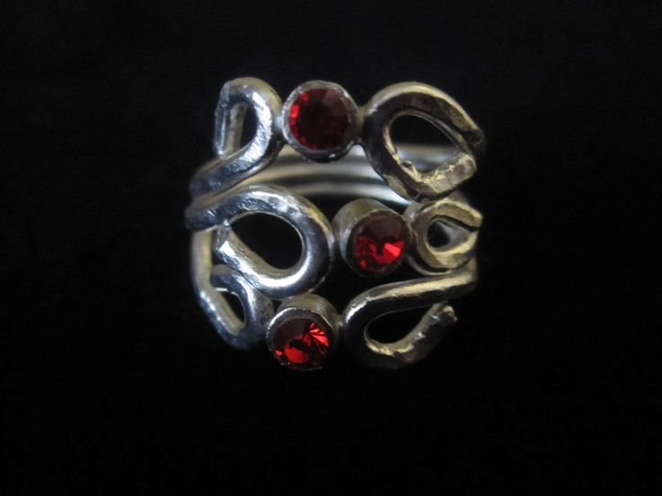 Going Loopy for Red.  Three red Swarovski crystals adorn this fine silver ring.