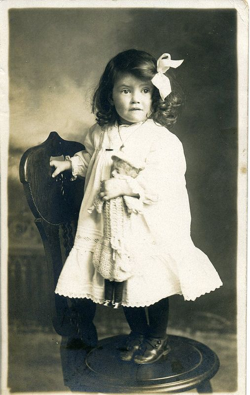 vintage photo of such an adorable little girl and her doll