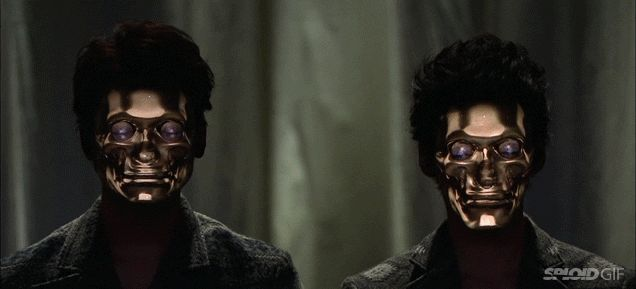 I'm both completely terrified and absolutely impressed by this amazing real-time face tracking and 3D projection mapping system that can digitally impose masks onto people's faces. It works amazingly well, like their faces have been completely replaced with new ones.