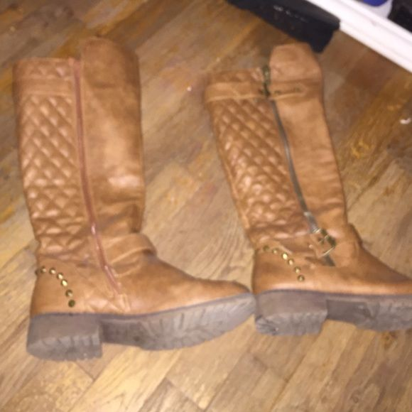 Long brown boots with zipper Knee high brown boots with zipper on the side. Small heel and small spikes by heel. Very cute and comfortable! Nature Breeze  Shoes Winter & Rain Boots