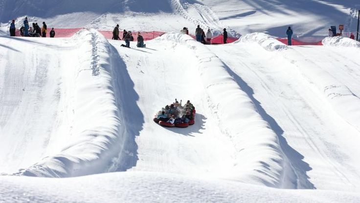 A chain of riders attack a snow tubing hill at Colorado's Copper Mountain Resort  http://mycoloradotravel.com