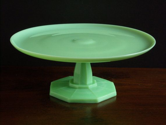 Fabulous vintage Jadeite green milk glass pedestal cake stand. Beautiful pale green color with a wonderful octagonal fluted pedestal base.
