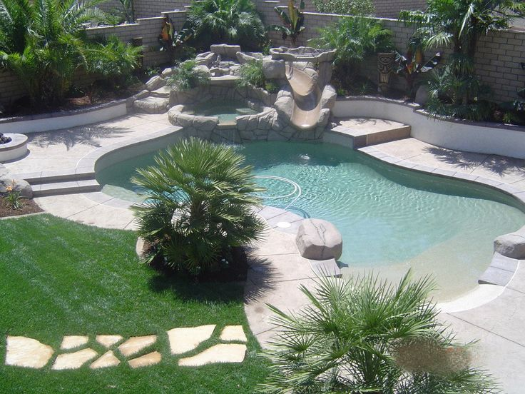 Tropical backyard tiki paradise in Corona, California. By Scarlett's Landscape, Inc. - http://scarlettslandscaping.com/ - My hounds would love this shallow entry to the pool!