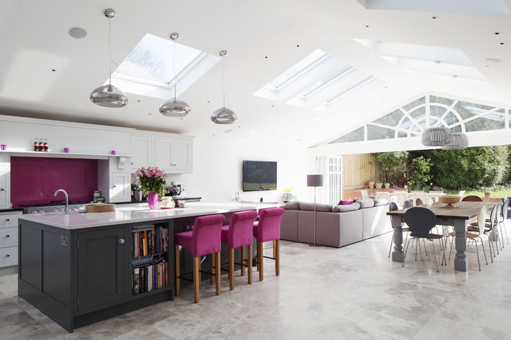 Rear extension | Open plan living | Large kitchen island with breakfast bar | vaulted ceiling | Bold colour accent | Connecting property to garden | Brighton Architects