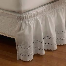 """Brimming with romantic style, this white cotton bed skirt showcases a scalloped hem and eyelet detail. Product: Bed skirtConstruction Material: 100% CottonColor: White Features: Easy-stretch designFits up to an 18"""" drop Dimensions: Twin/Full: 39"""" x 75"""" Queen/King: 60"""" x 80""""Cleaning and Care: Machine washable"""