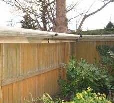Detailed information (but no diagrams or photos) on how to fence a garden area for cat safety.