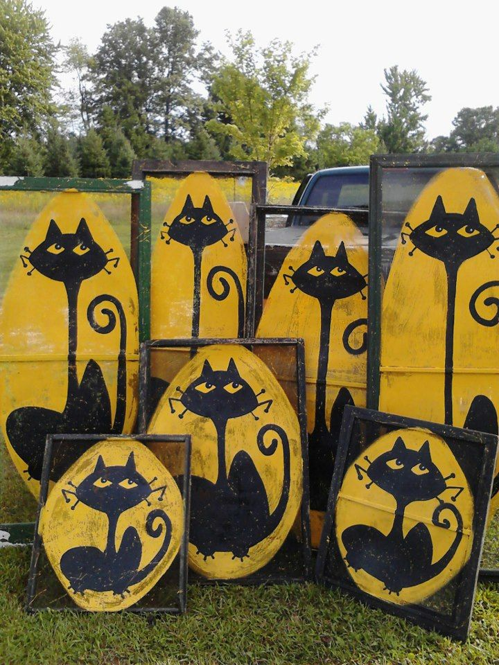 """wondering if our screens will really take paint this well? We have those giant """"gift boxes"""" we made for xmas lawn decor last year.  /  Halloween-themed painted window screens with black cats"""