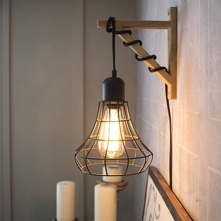 Great way to hang one of those IKEA-ish lights without having to hang it from the ceiling.